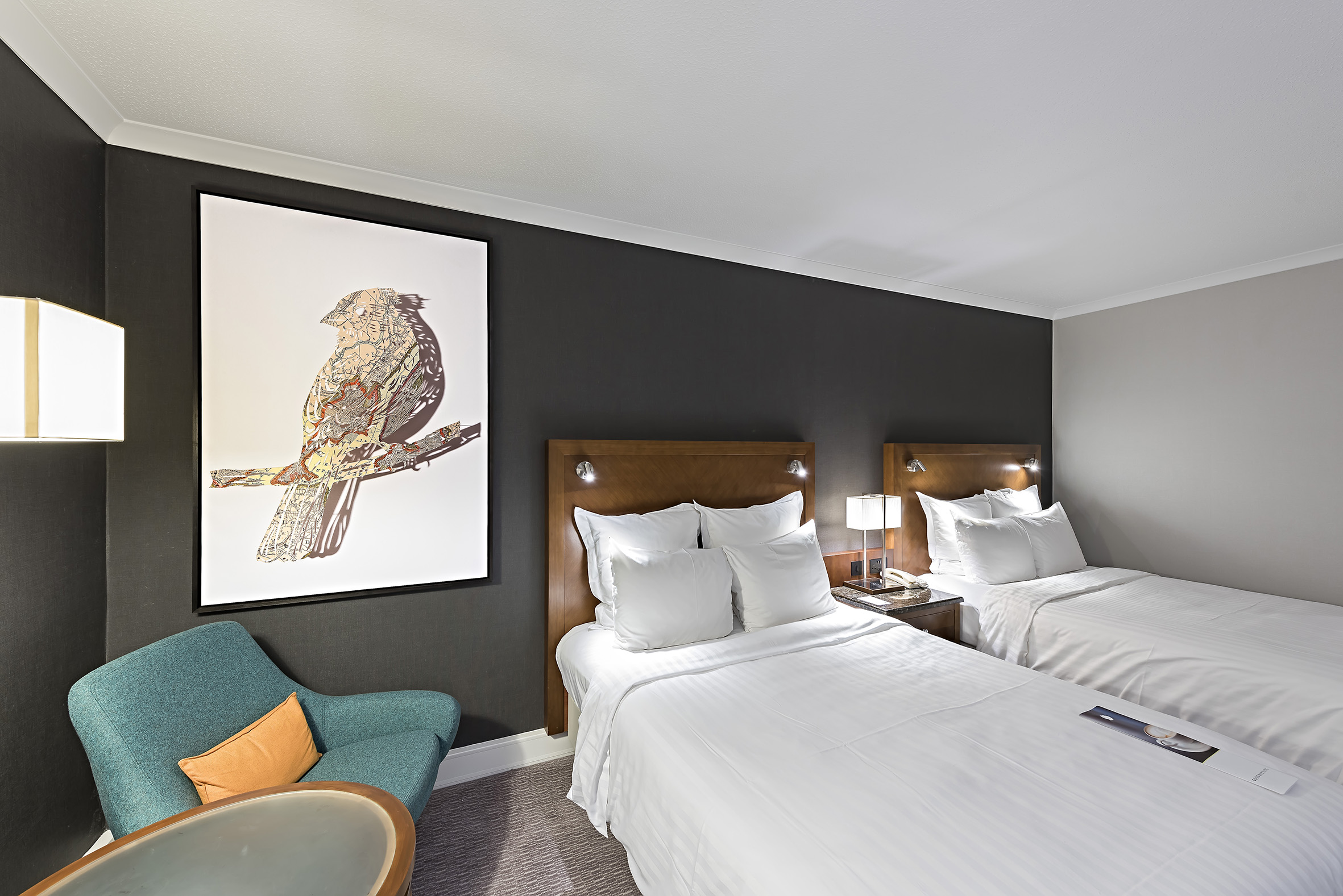 18  For the guestrooms, designed by Anita Rosato Interior Design, the art  is all by Claire Brewster